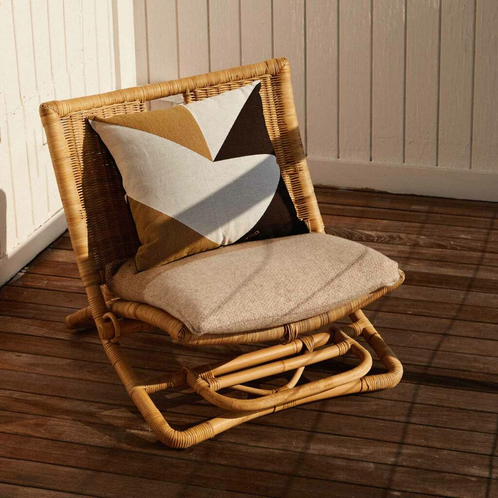 tapestry cotton jacquard white, black and brown pillow on a chair