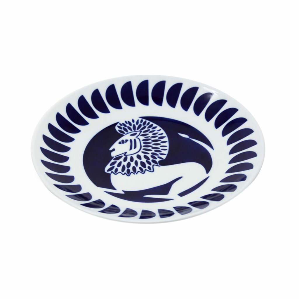 slanted porcelain plate with an illustration of the zodiac sign Leo