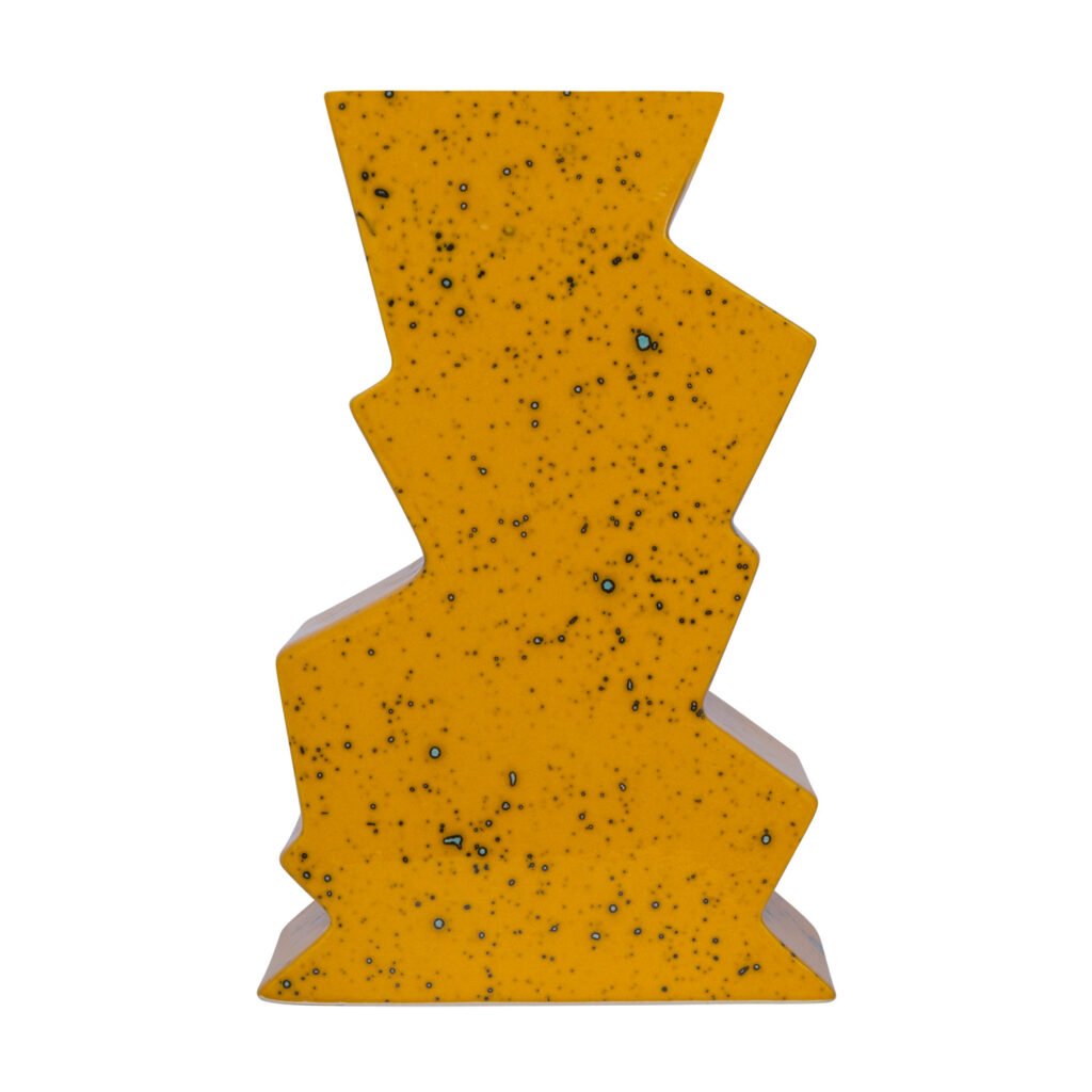 Handcrafted cubism ceramic yellow vase on white background.